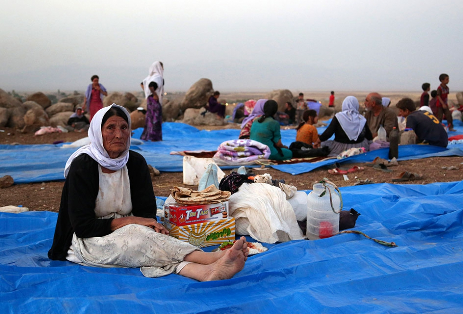 Displaced Iraqis settle at a camp at Derike, Syria, Sunday, Aug. 10, 2014. (AP Photo/ Khalid Mohammed)